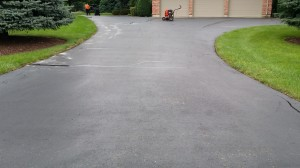 DRIVEWAY CLEANED,CRACKFILLED AND READY TO BEING SEALED