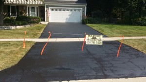 FINISHED DRIVEWAY SEALED WITH A HIGH GRADE COMMERCIAL SEALER