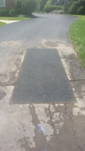 WE ADD NEW HOT ASPHALT AND COMPACT WITH PLATE COMPACTOR FOR A NICE, VERY DURABLE PATCH