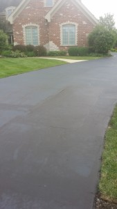 WE SEALED ENTIRE DRIVEWAY FOR A NICE UNIFORM COLOR
